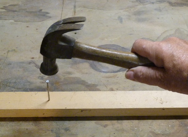 hammer used to sink nail